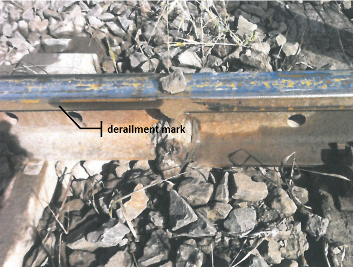 Figure 11: Photograph from the 11 September 2013 derailment, showing marks on the rail gauge face consistent with a left hand wheel dropping inside the common rail