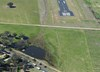 Figure 1: Aerial view of the accident site on the day, showing the threshold of runway 04 and direction of travel prior to impact. Source: NSW Police Force, modified by the ATSB