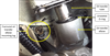 Figure 2: Photograph (in situ) showing fractured oil transfer elbow mounting lug and the unseated O-ring seal.  Source: Aircraft operator (annotations by the ATSB)