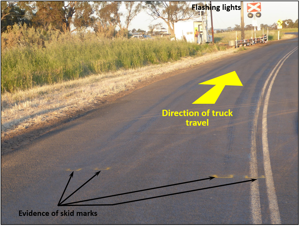 Figure 7:	View approaching railway crossing at 84 m, evidence of skid marks from road-train truck