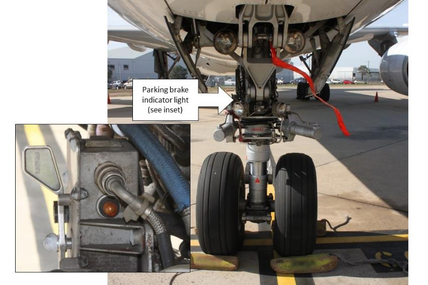 Figure 1: Nose landing gear showing the aircraft's park brake indicator light (note the wheel chocks in place)