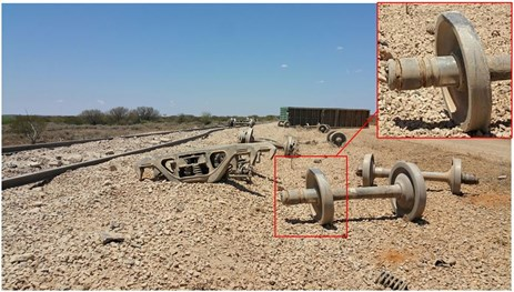 Figure 3: Photo of derailment site with the screwed journal axle in the foreground