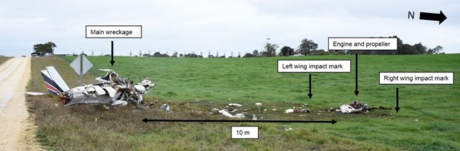 Figure 3: Accident site looking north-west, showing the engine and propeller location alongside the left and right wing impact marks, about 10 m from the main wreckage, which is upright and facing in a north-north-easterly direction