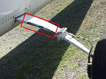 Some of the damage to Cessna 206, VH-WZX, after striking a fence the aircraft impacted with a tree.