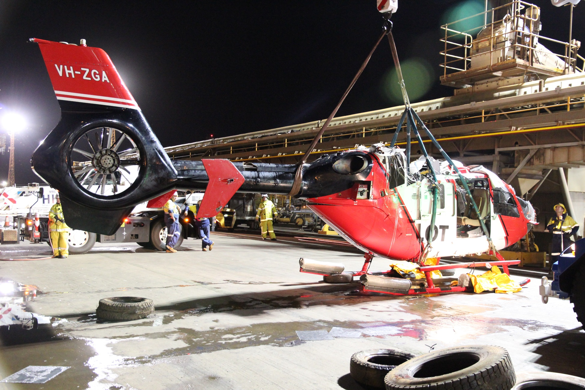 Investigation Ao 2018 022 Collision With Water Involving Twin Aerospace Wire Harness For Standard Figure 6 Helicopter Wreckage Being Lifted Onto The Dock