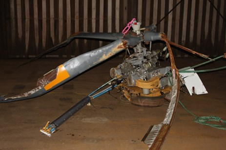 Figure 7: Main rotor blades and main transmission, showing damage in vicinity of the blade roots. Source: ATSB.