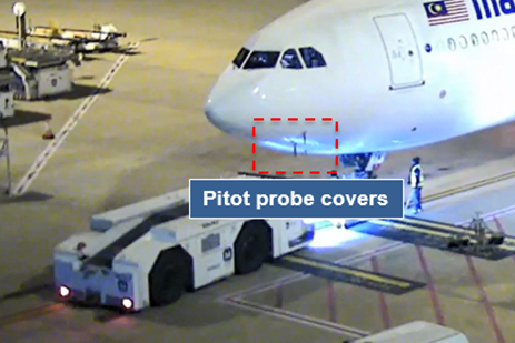 Figure 1: Aircraft about to be pushed back with pitot covers in place (two of three visible). Source: Brisbane Airport Corporation. Image annotated by ATSB.