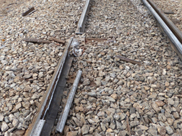 Fractured rail section in lower rail of curve