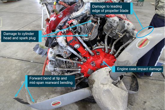 Figure 18: Damage to the engine and propeller, oriented upside down. Source: ATSB