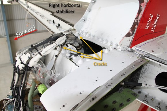 Figure 12: Damage in the centre leading edge section above the forward attachment points, included cracking and delamination in all corners of the cut-out and cracks in the ribs (not shown) and deformation of the material around the attachment points (not shown).