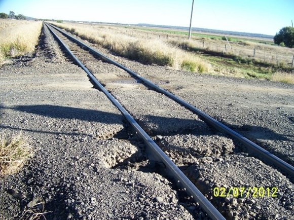 Figure 5: An image taken by the assessor during the July 2012 assessment of level crossing ID 2309. The assessors report recorded that the crossing gravel surface is breaking up and the track is 'pumping' and contributing to surface deterioration. 