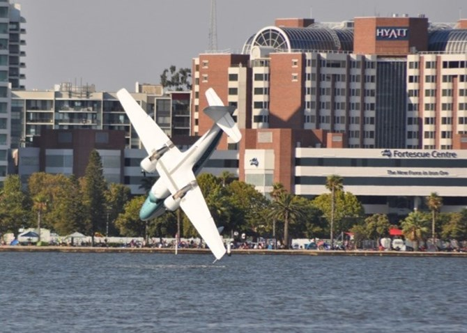 Grumman G-73 Mallard amphibious aircraft aerodynamically stalled over the Swan River and collided with the water during the air display, which was part of the City of Perth's Australia Day Skyworks event