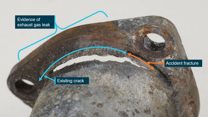 Accident aircraft's engine exhaust crack. Note pre-existing crack spread and widened during the impact. Source: ATSB